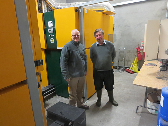 Principal Mike Pearson and Richard Hamilton with the KWB boilers